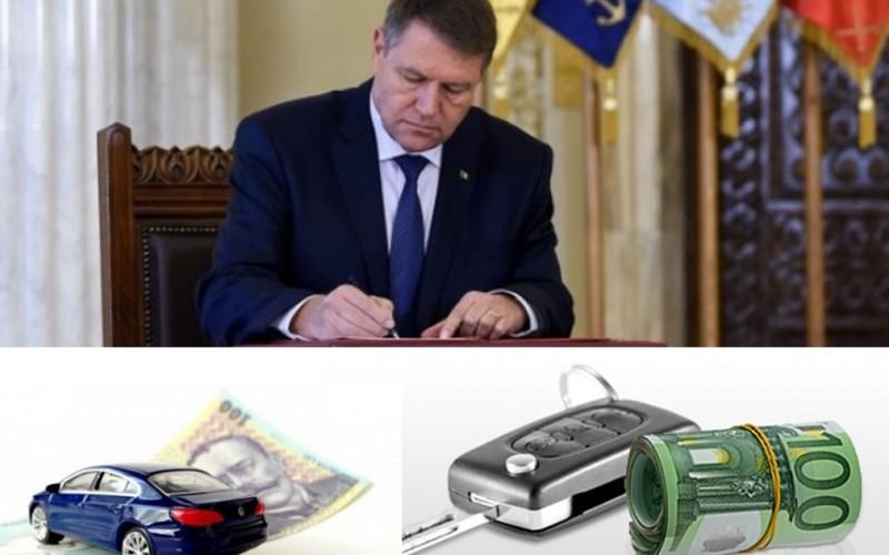 Adio taxa auto. Iohannis a promulgat legea prin care se elimină 102 taxe