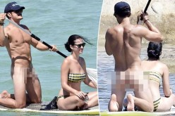 Orlando Bloom, fotografiat gol pușcă pe o plajă alături de iubită