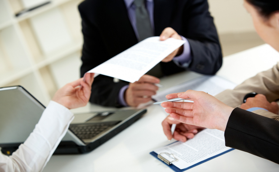 Businessman giving document to his colleagues
