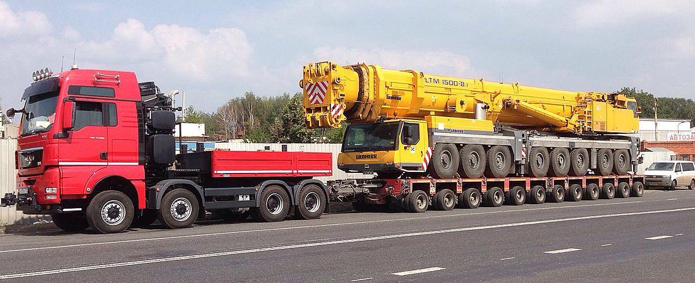 camion transport utilaj greu